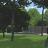 tuinhuis verborgen achter palenwand